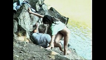 Sexy petite Latina deep throats on the lake